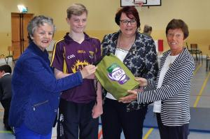 Catherine Neary and Marjorie McDonald present the school with bag of fresh sliotars.